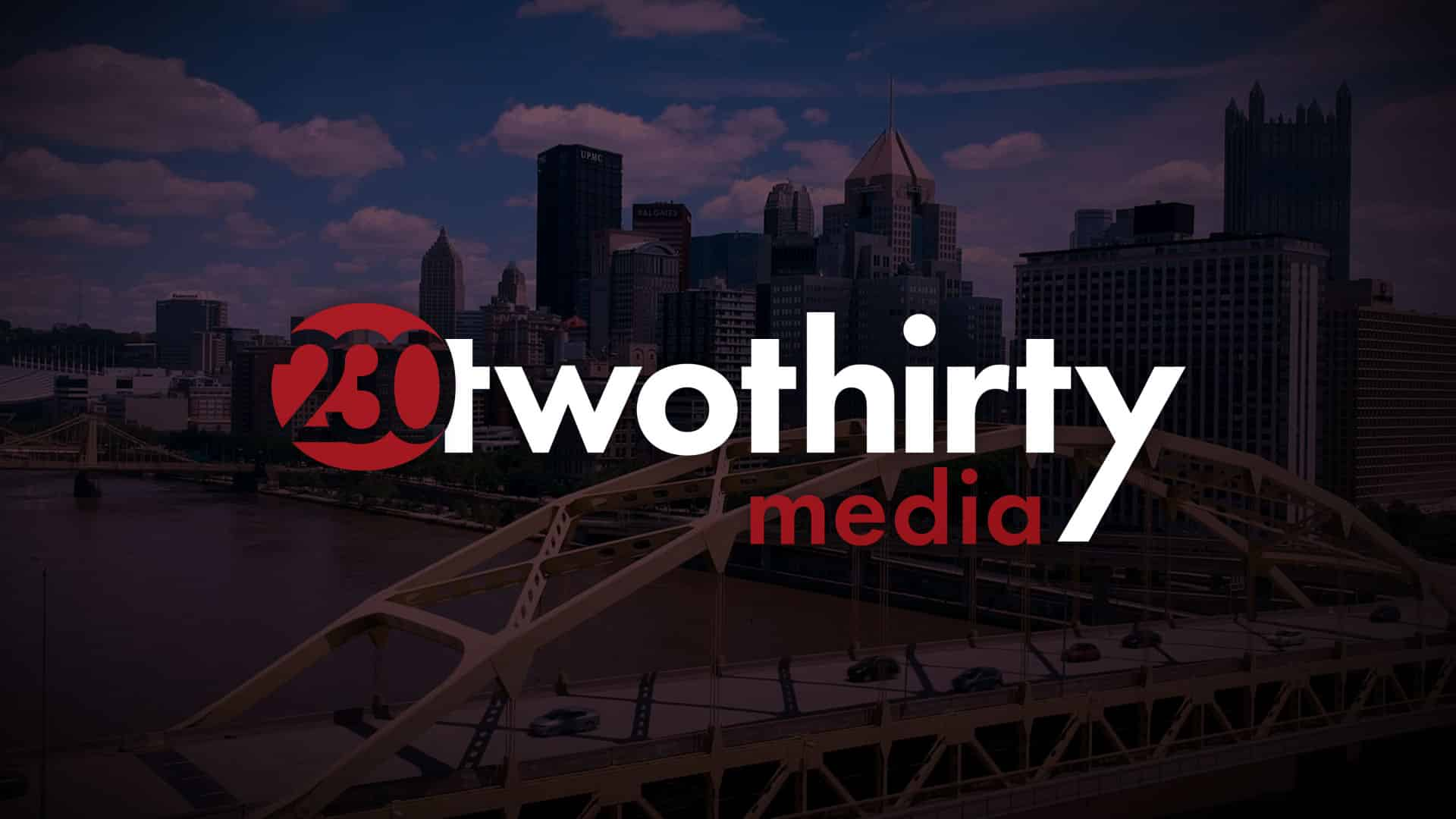 Twothirty Media logo over Aerial shot of Pittsburgh